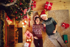 Happy love couple enjoying for Christmas at home