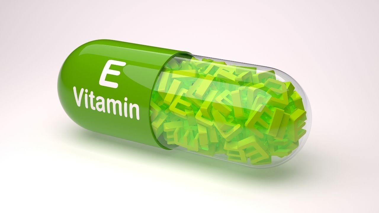 zielona tabletka z napisem witamina e